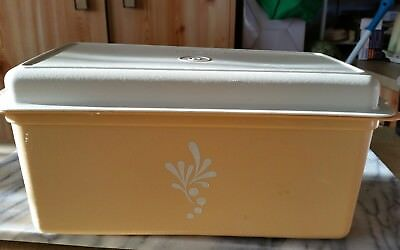 Tupperware bread holder used gold and brown..