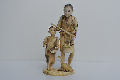 Japanese Carved Bovine Bone Elder Merchant and Boy - Meiji Period, c. 1890