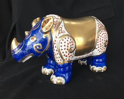 "Porcelain Rhinoceros, hand-painted, 13"" long, gold and blue"