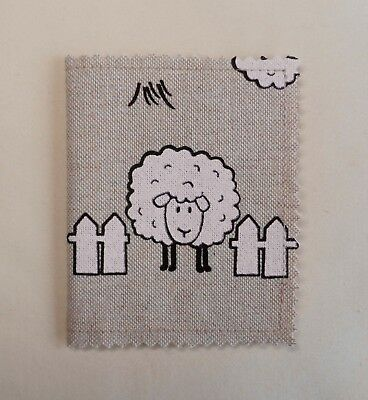 Handmade needle book. Linen look cotton fabric with a print of sheep. 10x8cm.
