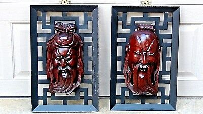 PAIR EARLY 20c CHINESE ROSEWOOD CARVED IMMORTAL MASKS ATTACHED TO METAL FRAME