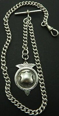 Antique silver albert pocket watch guard chain circa 1909 with silver fob medal