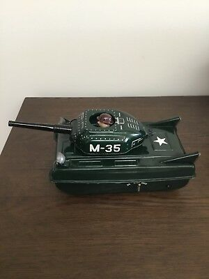 Vintage battery operated M35 tin Army tank toy