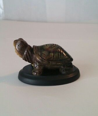 Carved Multi Colored Green Turtle On Black Stone Base