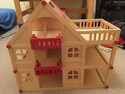 Wooden doll house with furniture and 4 dolls