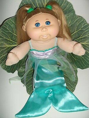Cabbage Patch Kid 2012. Blonde hair/blue eyes and Toothy Smile.