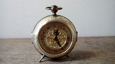 Vintage Ornate Brass Mechanical Alarm Clock On Three Legs. Working Condition.