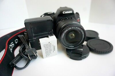 Canon EOS Rebel T3i with 18-55mm lens, caps, charger, battery and strap