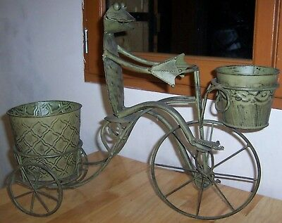 Wrought iron frog and are decorative vintage flower tricycle