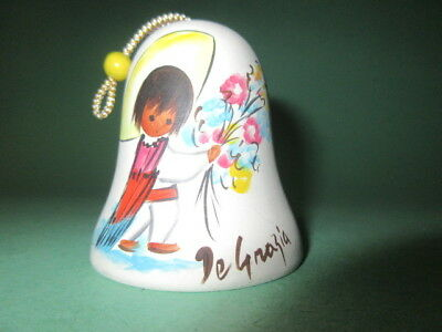 Sandstone    DeGrazia   Bell boy with flowers