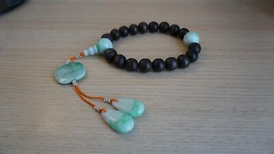 A Chinese wood prayer beads bracelet with jadeite finials