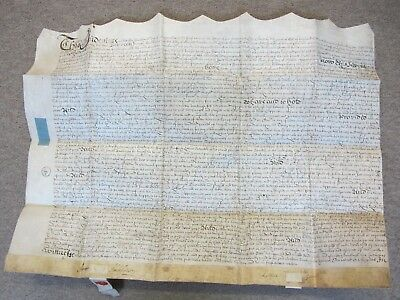 A manuscript indenture on vellum dated 1702 with two red wax seals approx. 26 in