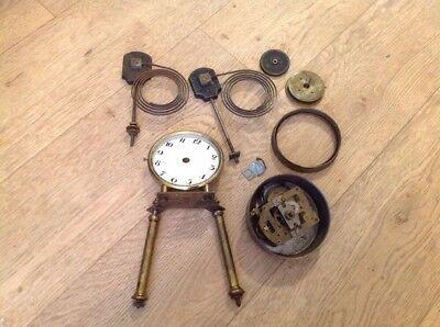 collection of old clock parts spares