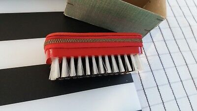 travel shoe brush with emergncy sewing kit inside