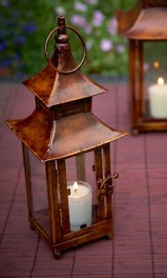 Summer Japanese pagoda garden lantern candle holder with copper colour finish.