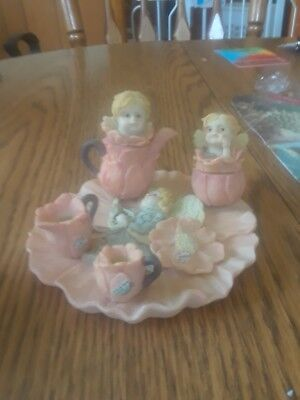 Two Precious little tea sets perfect for a little girls dollhouse.