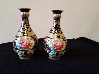 A pair of Antique Crown Staffordshire hand painted floral vases 6.0 inches