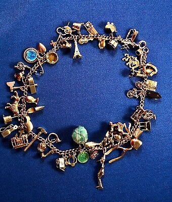 Vintage 14K Gold Charm Bracelet, double wrapped with 54 (some rare) charms