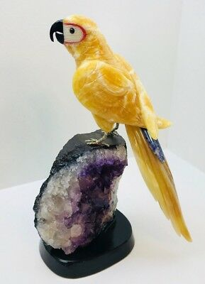 Orange Hand carved gemstone parrot perched on purple amethyst rock blue tail