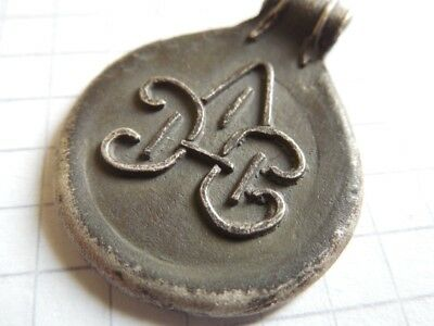 Viking period silver pendant with initials