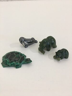 Collection of small carved animals including jade bears and malachite turtle