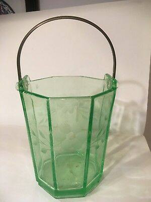 Green depression glass ice bucket in perfect condition.