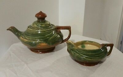 .SIGNED MARGUERITE MAHOOD GUMLEAF Teapot and milk jug. Early period.