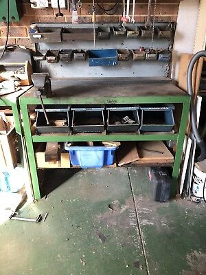 Workbench Industrial Steel Work bench with vice and storage.