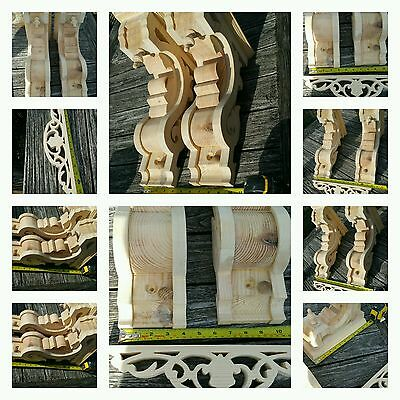 A pair of Gothic Victorian Corbels plus one decerative centerpiece