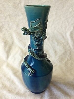 Qing Dynasty turquoise monochrome bottle vase applied Dragon kylin.