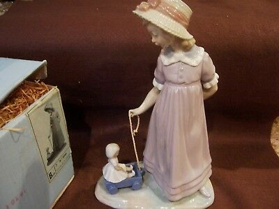 Lladro Spain, #5044, girl with doll in wagon, with box, Mint