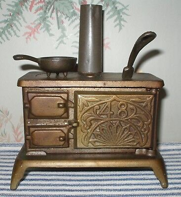 """TINY EARLY 1900's """"48"""" Cast Iron Toy Stove, J & E Stevens, Nickel-Plated Antique"""