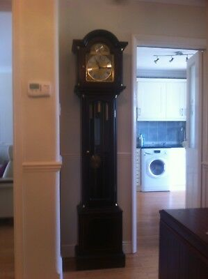 Mahogany 8-Day Westminster Chiming Grandfarther clock.