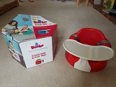 Bumbo seat with straps and tray. Red and white. Box included.