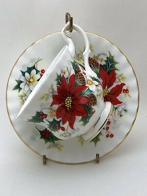 Royal Albert Poinsettia Tea Cup and Saucer Bone China England 1976 Yuletide Xmas