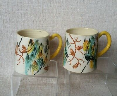 Pair of John Perceval AMB Coffee Cups. Highly decorated.