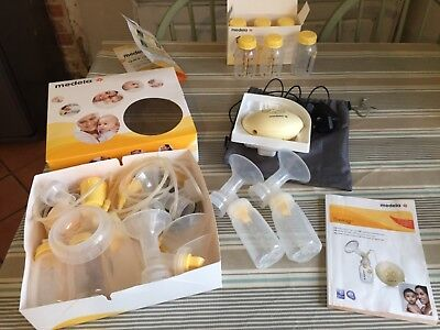 medela swing electric breast pump (used condition)with lots of accessories