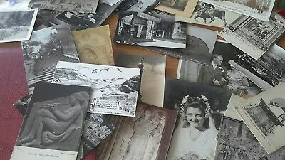 old photograph album with postcards and photos