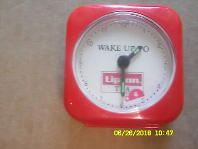 Vintage clock Wake Up to Lipton Tea. Has second hand with tea cup going around.