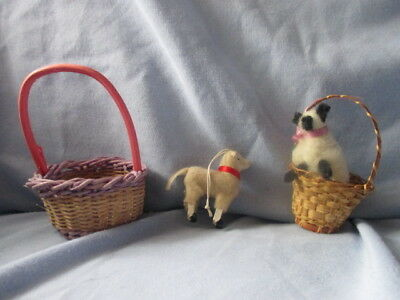 2 miniature straw Easter baskets with lambs in them