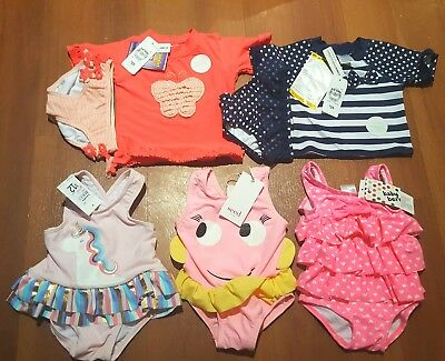 size 00 baby girl bathers. new with tags. price is for all
