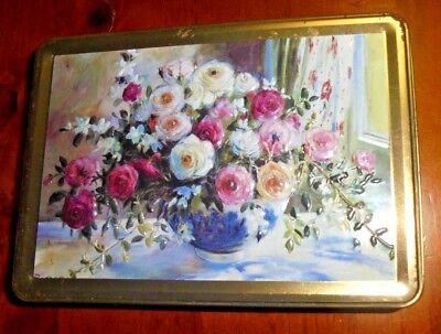Old collectable tin ~ Embossed flowers in vase pictured on lid