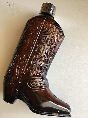 Avon western boot bottle.14.5 tall.Discoloured lid. brown glass.No chips.Vintage