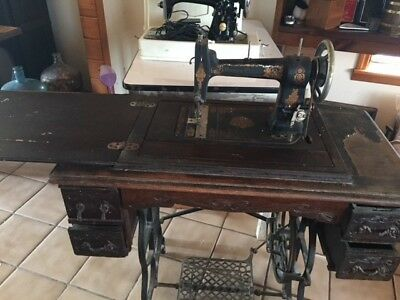 """Antique sewing machine, 1884, """"Roman Queen"""" in wood cabinet"""
