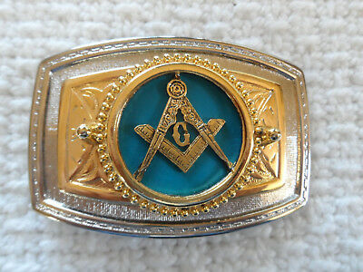 gold and silver tone metal Masonic belt buckle with  aqua blue background