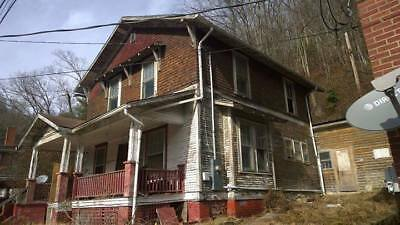 House for sale large 1914 with character. Needs work. No liens.