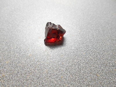 Red  garnet faceting rough. 12.9 cts. clean.