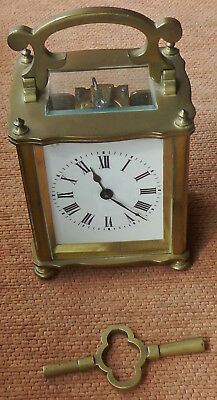 EARLY 20th CENTURY HEAVY BRASS CARRIAGE CLOCK HEIGHT 10cm WITH HANDLE LAYED FLAT
