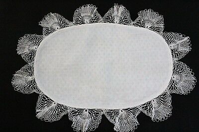 Vintage oval shaped cloth with dotted centre and fine crochet edge.