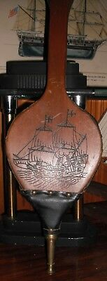Vintage fireplace bellows with carved tall ship, leather bellows and brass tip.